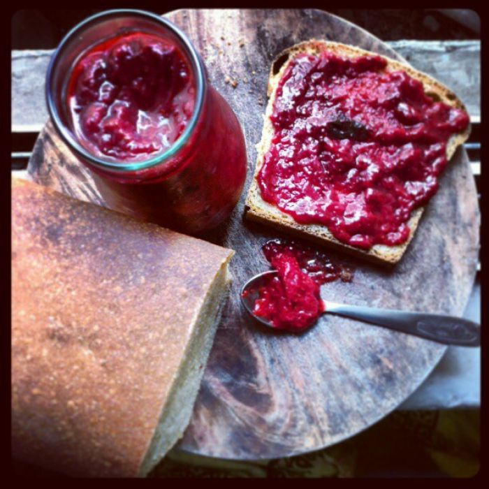 a jar of strawberry-mint jam and home made mread.
