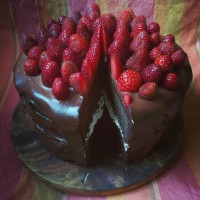Dark chocolate and strawberry celebration cake, with a nougat layer in the middle