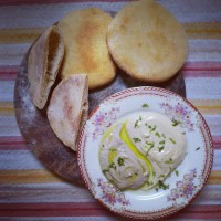 Golden home made Pita, with ultra smooth hummus and Baba Ganoush
